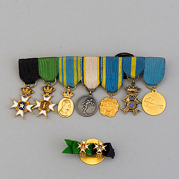 A set of seven Swedish minature orders of merit and medals and two minature buttons.