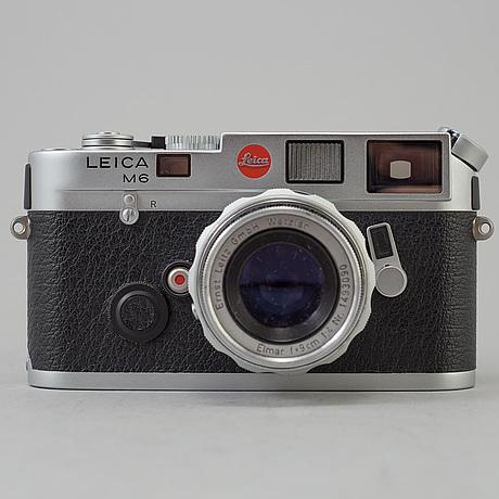 A chrome body leica m6 no 2422201.  from 1997 with elmar f=9 cm 1:4 no 1493090.