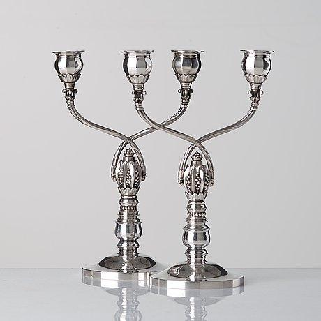 Johan rohde, a pair of sterling candelabra, design nr 343 for georg jensen & wendel, denmark 1945-51.