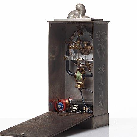 Nils fougstedt, a pewter table clock, svenskt tenn, sweden 1925.