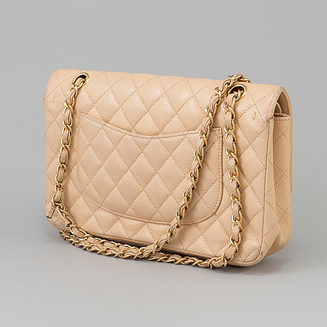 """A """"double flap bag medium"""" by chanel, 2010 2011"""