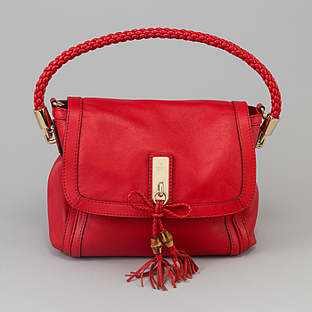Handbag by Gucci.
