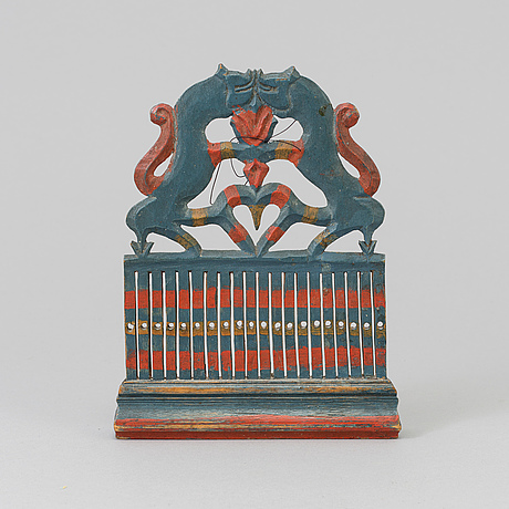 A painted wooden loom from the 19th century