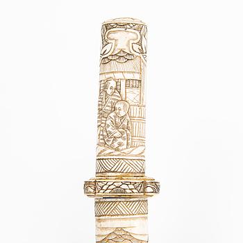 A Japanese Meiji period carved bone Tanto.
