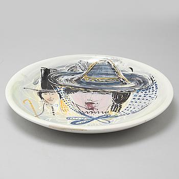 A stoneware plate, signed MS, Kupitta,  20th century.