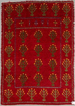 A 19th century rug. Circa 186 x 131 cm.
