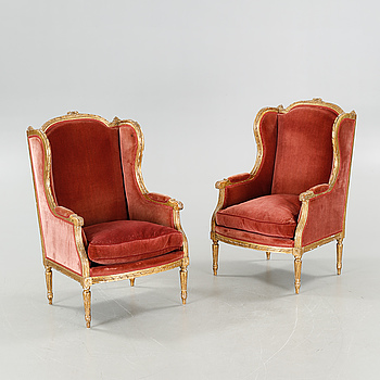 A pair of lounge chairs from the first half of the 20th century.