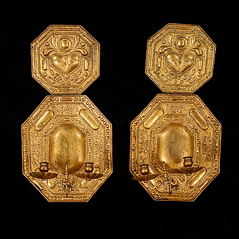 A pair of baroque style candle holders, around the year 1900.