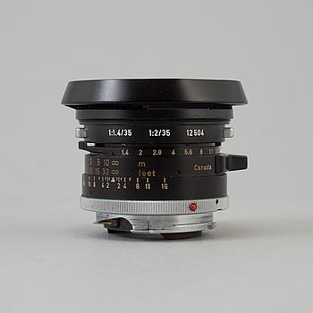 A black Leica Summilux 1:1.4 /35 Leitz  Lens no 2391303, Canada.