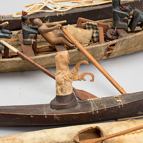 AN UMIAK AND THREE KAJAKS MODEL BOATS GREENLAND WITH FIGURES