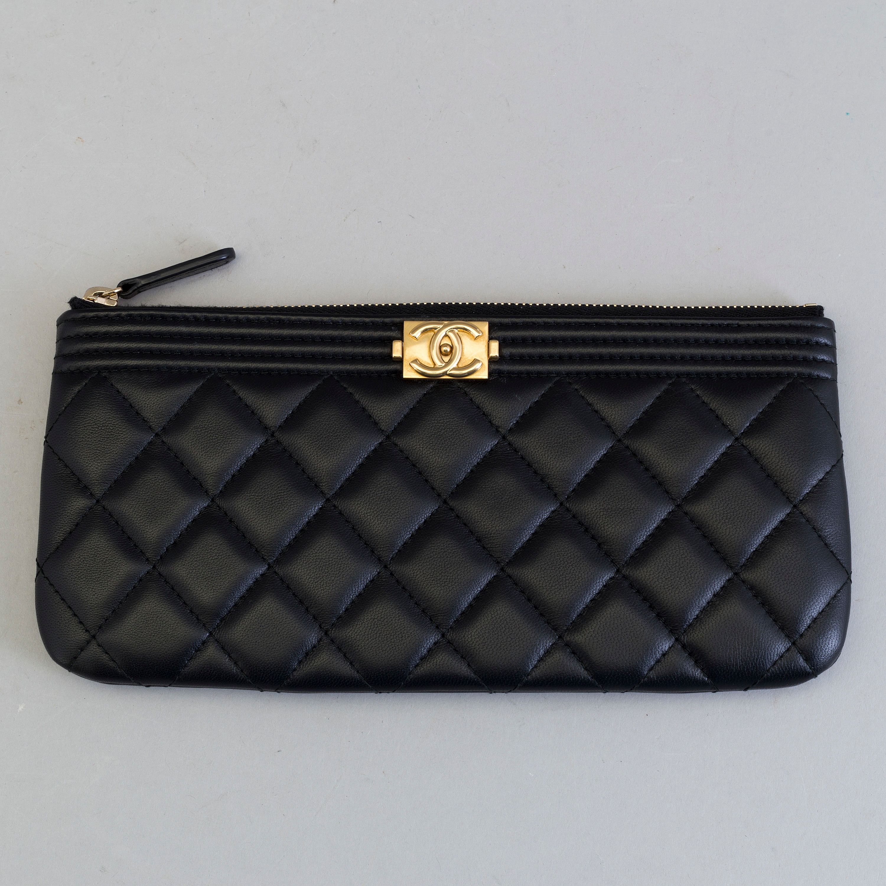 A LEATHER CLUTCH BAG by Chanel. - Bukowskis 3946d37a5ff6d