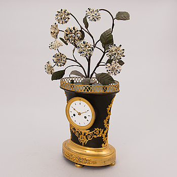 A MANTLE CLOCK, Empire early 19th century.
