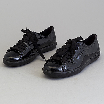 A pair of PRADA black patent leather sneakers.