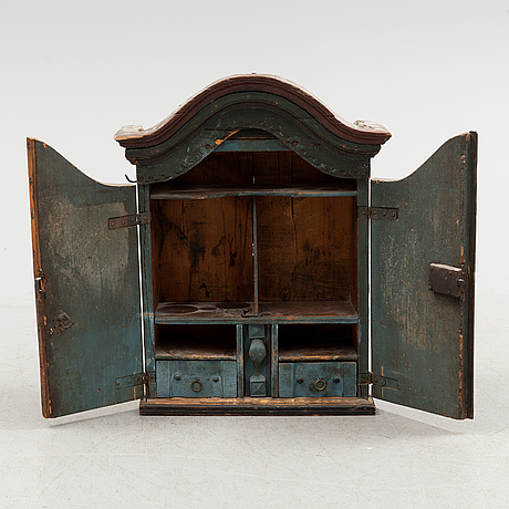 A wooden cabinet from 1843