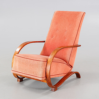An armchair made in the mid 20th century.
