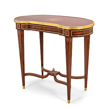 A Directoire style marquetry table from around year 1900.