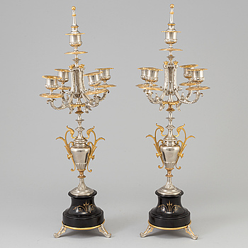 A pair of French gilt and silvered bronze candelabra, late 19th Century.