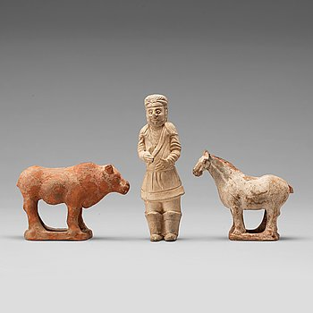 Three pottery scultpures of animals and a herdsman, Tang dynasty (618-906).