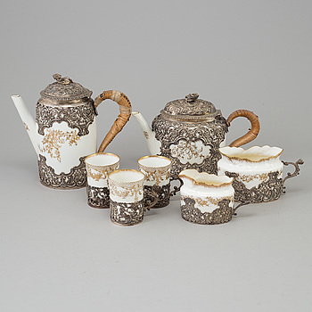 A mid 19th century seven piece tea service, Staffordshire, with silver work presumably by  William Comyns, London, 1894.