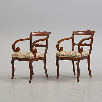 EMPIRE, A pair of late Empire mahognay armchairs, mid 19th century.