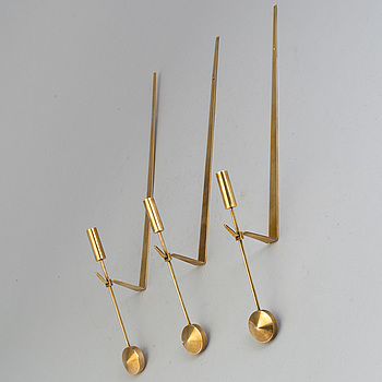 PIERRE FORSSELL, PIERRE FORSSELL, three brass wall sconces from Skultuna.