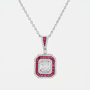 A faceted ruby and brilliant- and baguette cut diamond pendant.