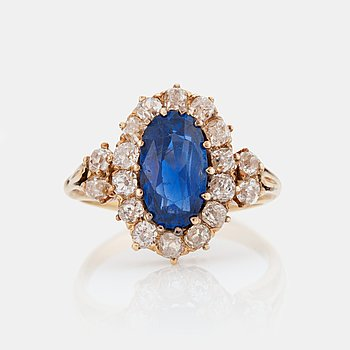 780. A RING set with a mixed-cut sapphire.