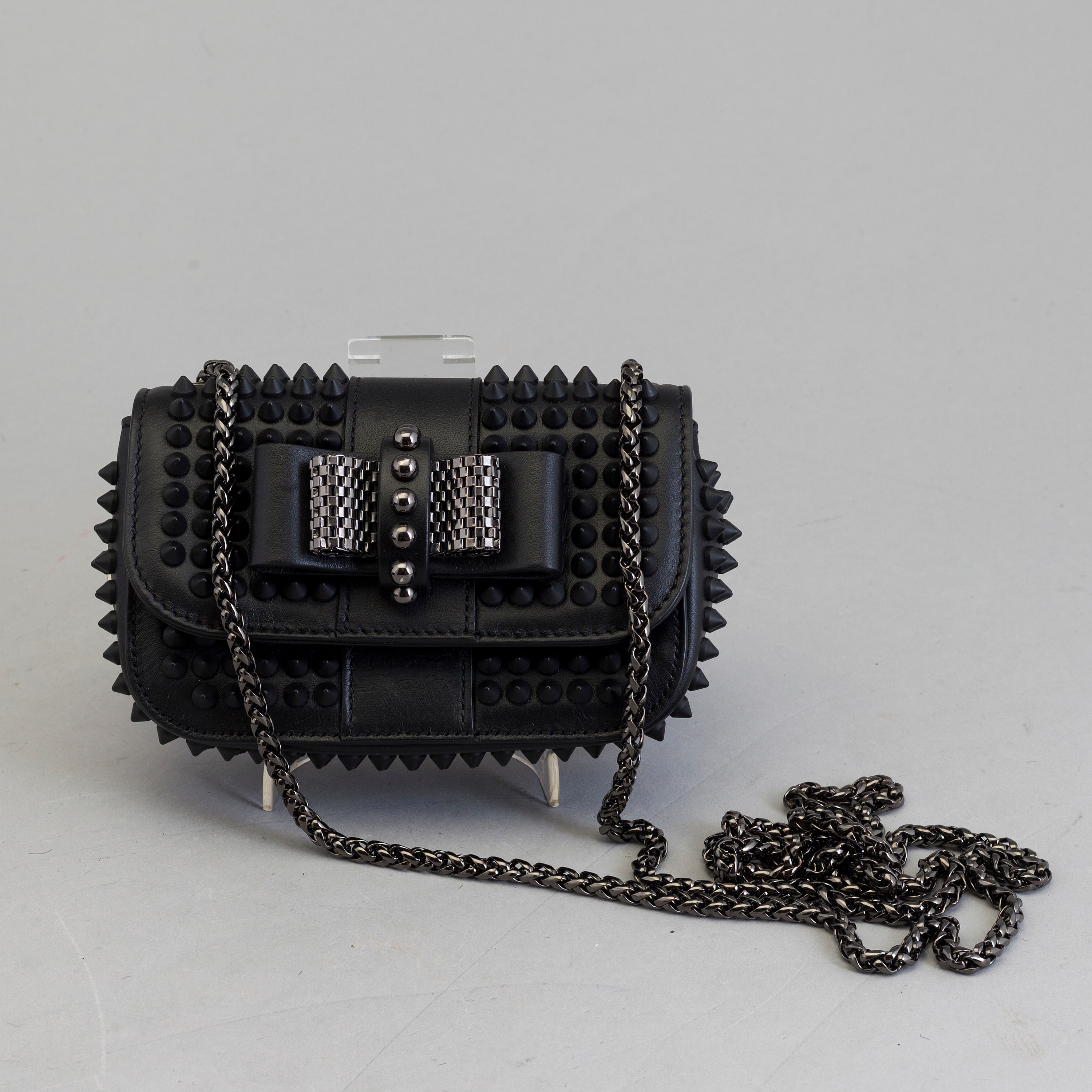 plus de photos e4db9 1957a An eveningbag with studs by Christian Louboutin. - Bukowskis