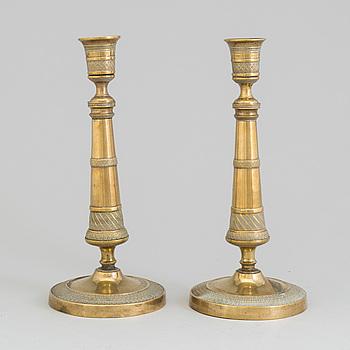 LJUSSTAKAR, ett par, brons, empire, 1800-talets första hälft.
