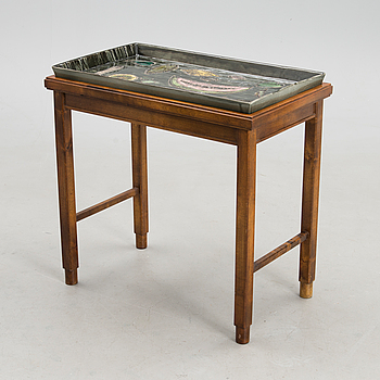 A stoneware tray table signed Bryk.
