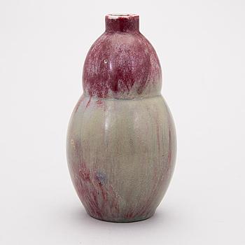 A ceramic vase signed A.W.F.