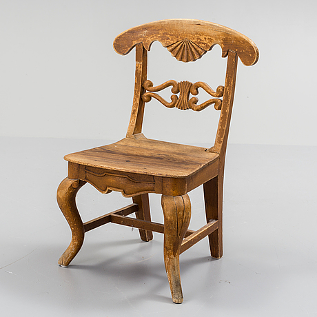 A wooden childrens chair from the 19th century