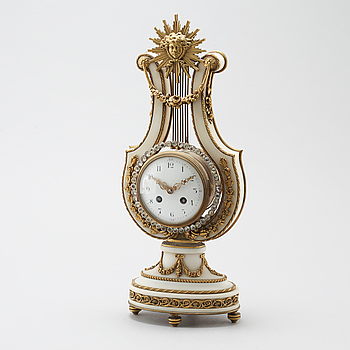 An empire style table clock from France, around the year 1900.