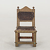 An ashanti chair, ghana, hardwood with brass studs, ca 1900