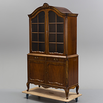 a rococo style vitrine cabinet from the middle of the 20th century.
