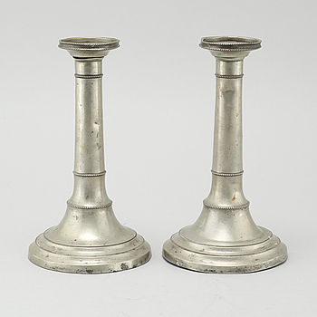 A pair of pewter candlesticks, made 1816.