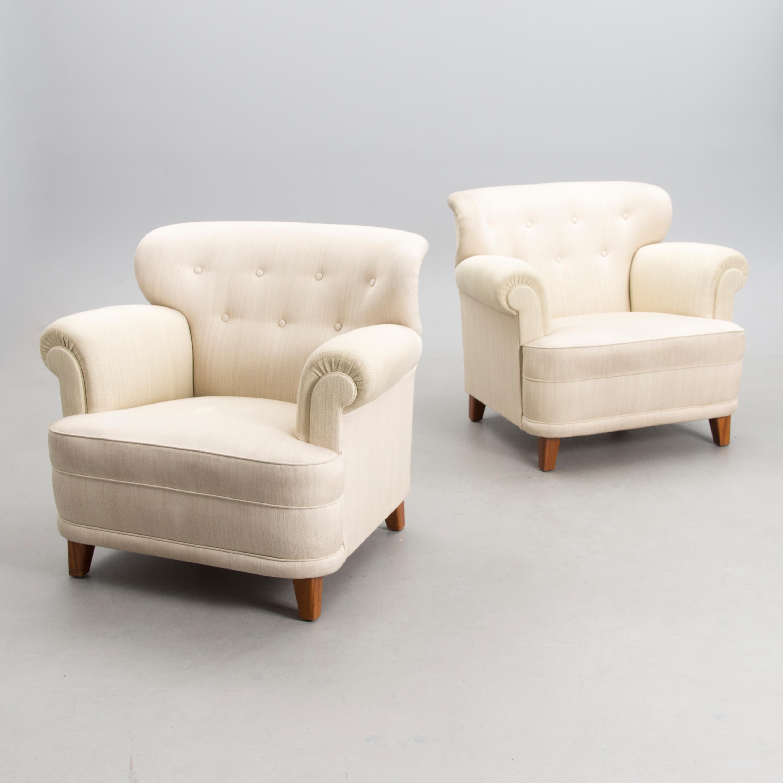 CARL-JOHAN BOMAN, A pair of 1940s armchairs \'London\' for Oy Boman Ab ...