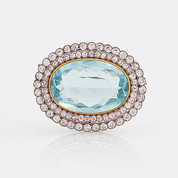 778. A BROOCH set with an aquamarine and old-cut diamonds.