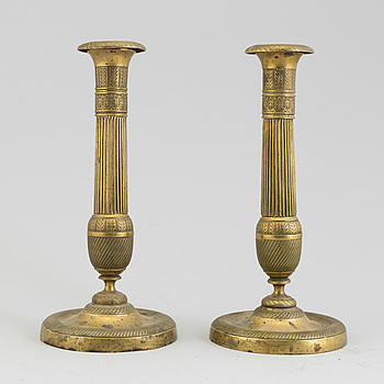 EMPIRE, A PAIR OF EMPIRE BRONZE CANDLESTICKS, first half of the 19th century.
