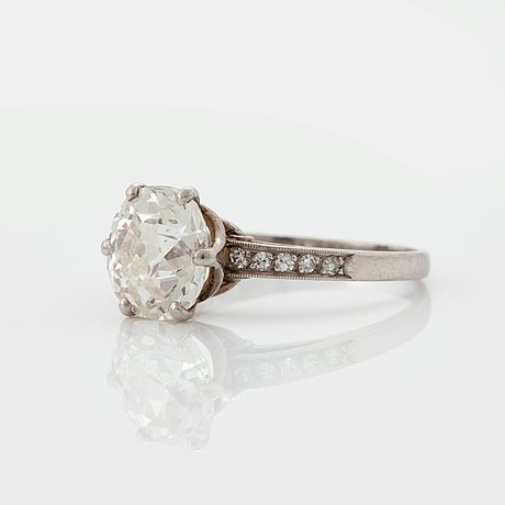 A ring set with an old-cut diamond.