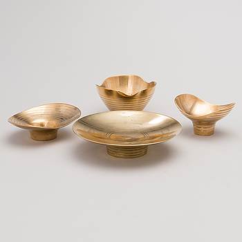 A set of four bowls for Oy Taito Ab.
