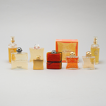 HERMÈS, seven factices and one perfumebottle.