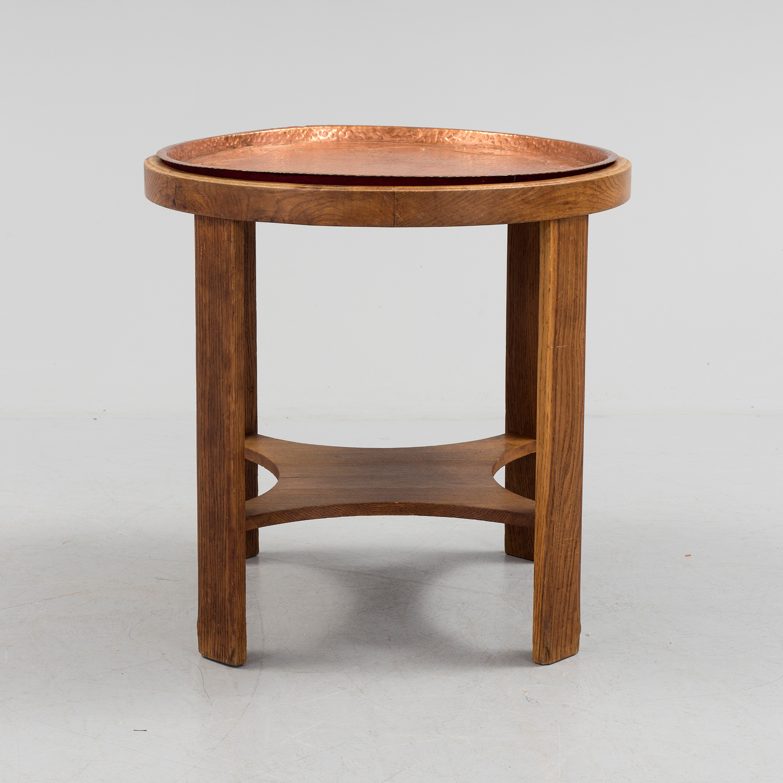JUGEND A early 20th century Jugend oak coffee table with copper