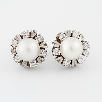 A pair of cultured pearl and brilliant cut diamond earrings.