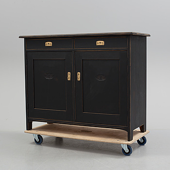 An early 20th century painted cupboard.