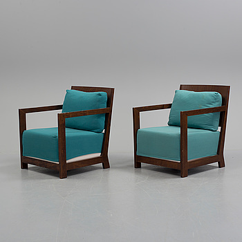 a pair of armchairs from the second half of the 20th century.