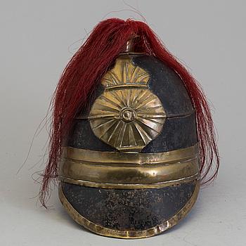 KASK, troligen teaterrekvisita, mässings- och järnplåt, empire, 1800-talets första hälft.