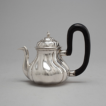 An 18th century silver tea pot, unidentified makers mark, Northern Europe.