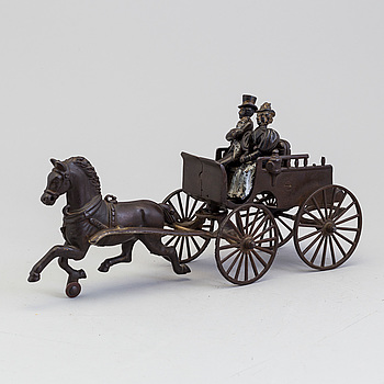 a cast iron horse-drawn carriage, USA, early 20th century.