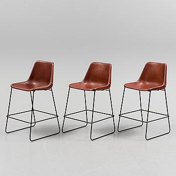 A set of three Giron bar chairs.